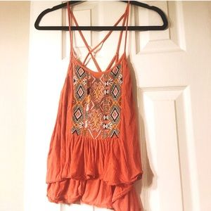 Orange embroidered tank top with back detailing.